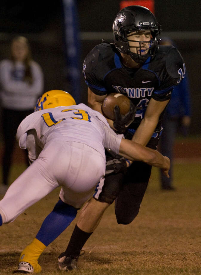 Trinity's Peter Rodenko tries to get around Dallas Lutheran's Logan O'Bryan Friday 11-6-2015 at Coombes Field. Tim Fischer\Reporter-Telegram Photo: Tim Fischer
