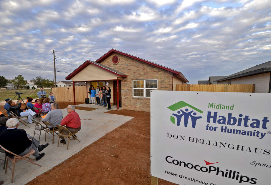 Habitat home dedication for Linda Corbell and her children on Tuesday, Nov. 10, 2015, at the Habitat for Humanity development on Cloverdale Road. James Durbin/Reporter-Telegram Photo: James Durbin