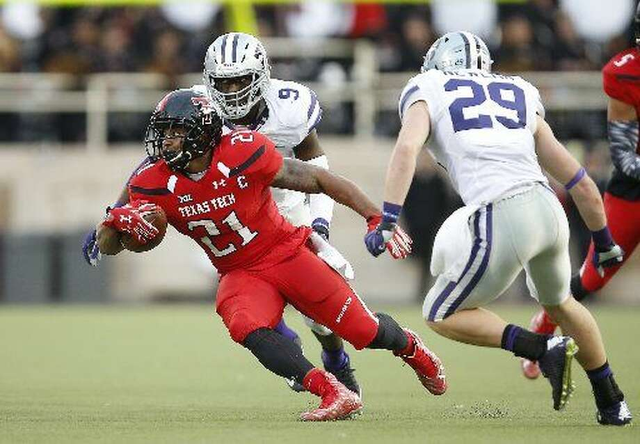 Texas Tech running back DeAndre Washington tries to turn away from Kansas State defensive back Sean Newlan during an NCAA college football game Saturday, Nov. 14, 2015, in Lubbock, Texas. (Brad Tollefson/Lubbock Avalanche-Journal via AP) Photo: Brad Tollefson/Lubbock Avalanche-Journal Via AP