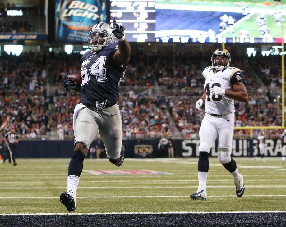 Dallas Cowboys linebacker Bruce Carter, left, celebrates as he returns an interception 25 yards for a touchdown in the fourth quarter of an NFL football game against the St. Louis Rams, Sunday, Sept. 21, 2014, in St. Louis. (AP Photo/St. Louis Post-Dispatch, Chris Lee) EDWARDSVILLE INTELLIGENCER OUT; THE ALTON TELEGRAPH OUT Photo: Chris Lee