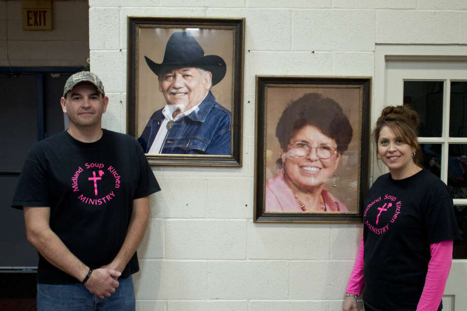 Jason and Nancy Ivy stand next to portraits of her parents Mariano and Mary Rendon who started the Midland Soup Kitchen. Nancy has now taken over the task of running the nonprofit.