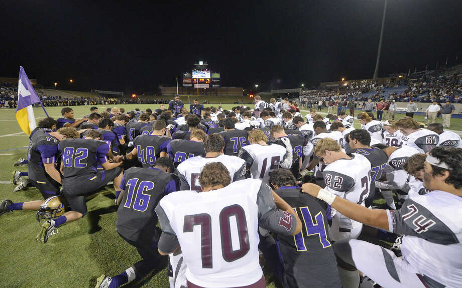 Lee and Midland High football players pray together before the start of the game Friday, Nov. 6, 2015, at Grande Communications Stadium. James Durbin/Reporter-Telegram Photo: James Durbin