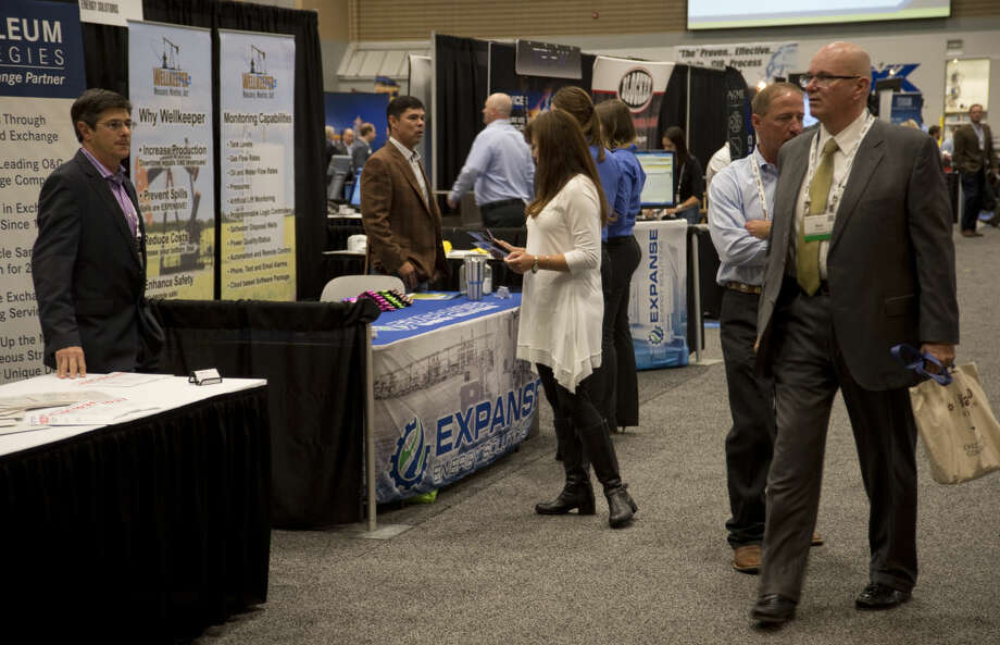 Attendees at the Executive Oil Conference talk with oil and gas companies Tuesday 11-10-2015 during breaks in the presentations. Tim Fischer\Reporter-Telegram Photo: Tim Fischer