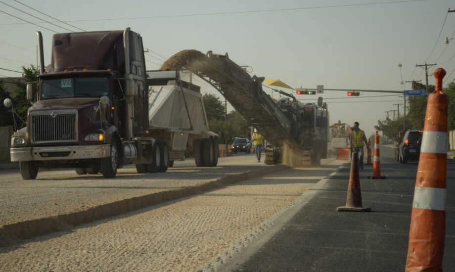 Construction crews work on removing the road surface on Midland Drive Wednesday morning as they prepare it for resurfacing. Tim Fischer\Reporter-Telegram Photo: Tim Fischer