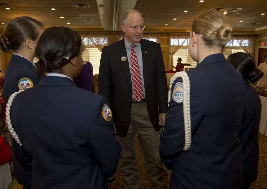 U.S. Rep. Mike Conaway talks with Midland High JrROTC Honor Guard members, Cadet Sr. Airman Maria Hall, Cadet Airman 1st Class Nikayla Johnson, Cadet 1st Lt. Natalie Jarratt and Cadet Major Cinthia Aguiler Wednesday 11-11-2015 before the Midland County Republican Women's luncheon at Midland Country Club. Tim Fischer\Reporter-Telegram Photo: Tim Fischer