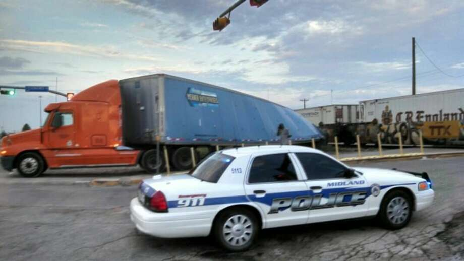 A train collided with a tractor-trailer Monday at Wall Street and Eisenhower Drive. Rye Druzin/Reporter-Telegram Photo: Rye Druzin/Reporter-Telegram