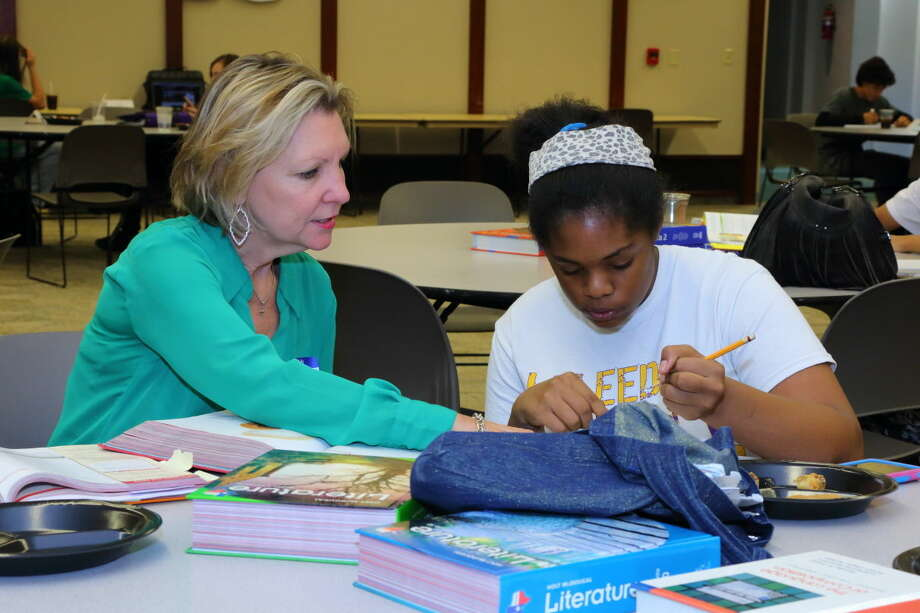 Midland High juniorTatywanna Atchisonreceives help from tutorDebbie Byrd during '1 TO 1' tutoring at First Presbyterian Church of Midland in October 2015. Photo by Curtis Routh
