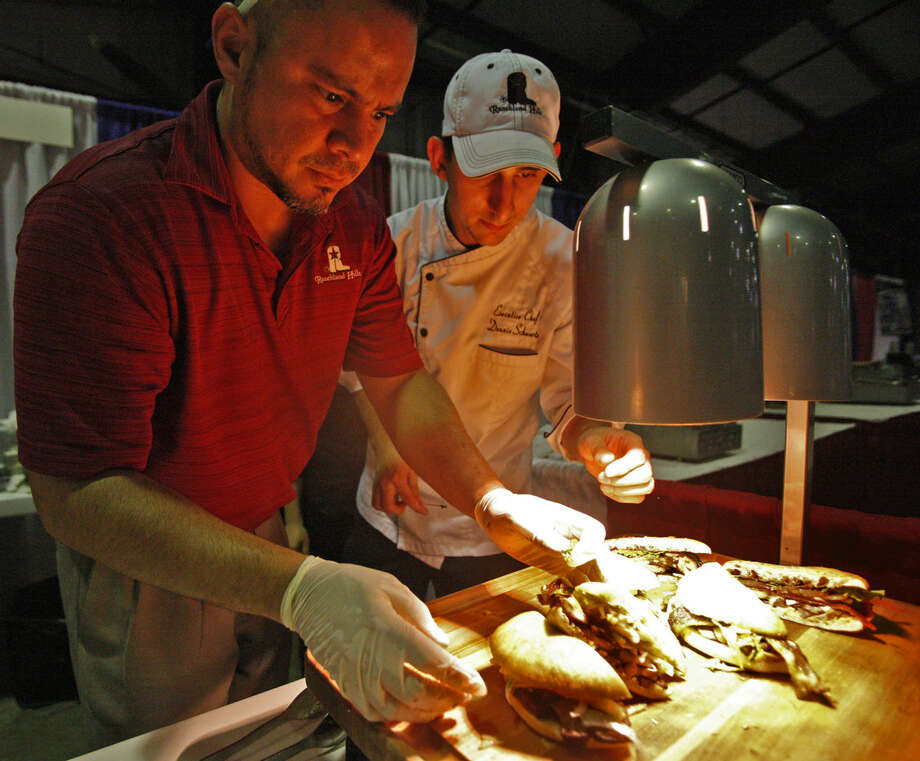 Donnie Schwartz, executive chef at Ranchland Hills Country Club, lays out sandwiches with pan-seared duck focaccia and roasted pork belly focaccia during the Taste Of The Basin on Thursday at the CAF hanger. James Durbin/Reporter-Telegram Photo: James Durbin