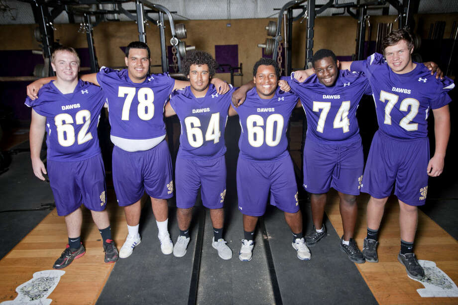 Midland High offensive lineman from left, Matt Mosley (62), C.J. Carillo (78), Lee Payan (64), Robert Evans (60), Oshay Scott (74), Paxton Heiting (72) in portrait at the MHS field house on Thursday. James Durbin/Reporter-Telegram Photo: James Durbin
