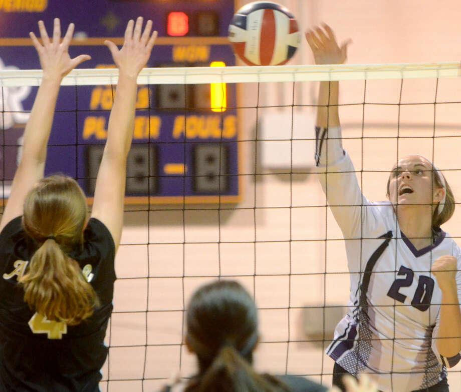 Midland High's Claire Lancaster (20) hits against Abilene on Friday at MHS. James Durbin/Reporter-Telegram Photo: James Durbin