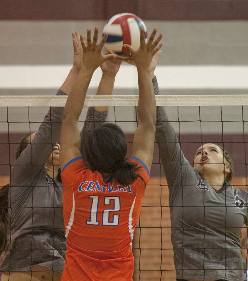 Lee High's Alissa Erdwurm and Jen Jeter go up to block San Angelo Central's Brilyn Daniels Friday at LHS. Tim Fischer\Reporter-Telegram Photo: Tim Fischer