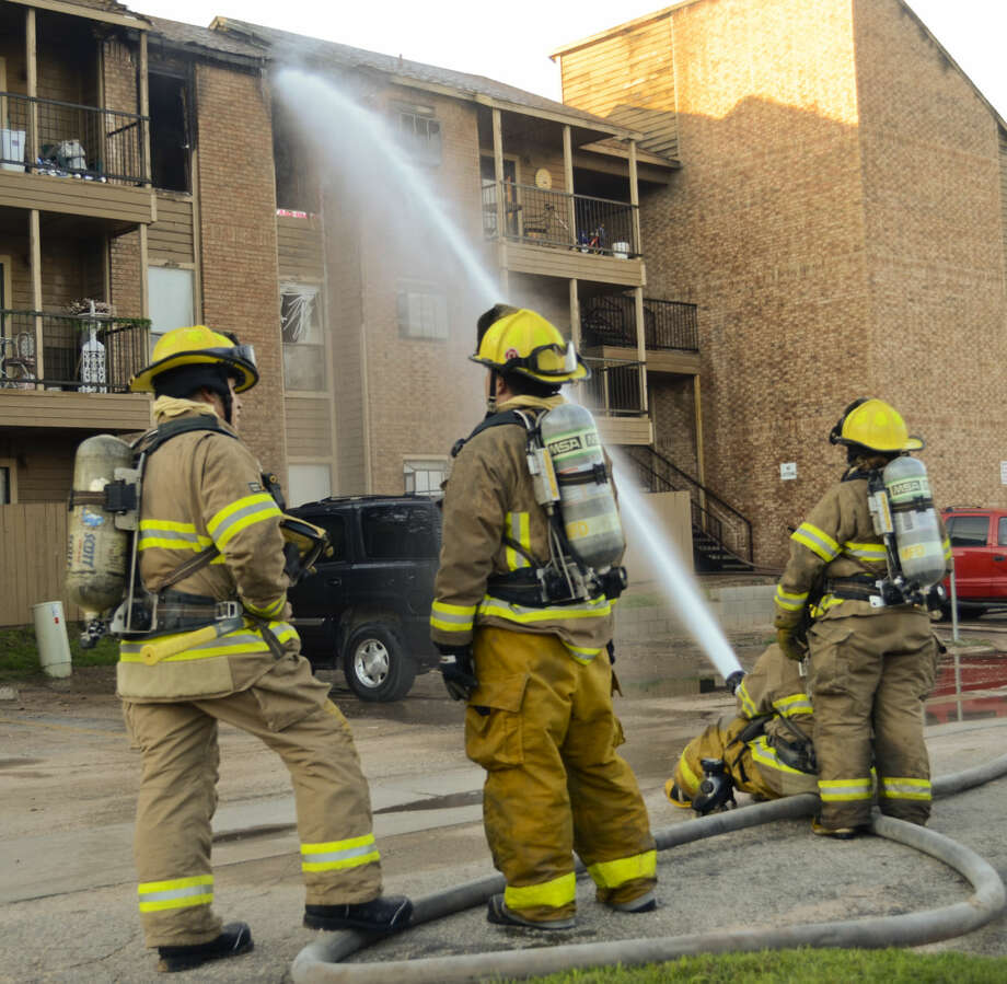 Midland fire crews work to put out a fire in a third-floor apartment at Ranchland Hills Apartments early morning on Sept 26. One resident was taken to Midland Memorial Hospital for smoke inhalation. Photo: Tim Fischer/Reporter-Telegram