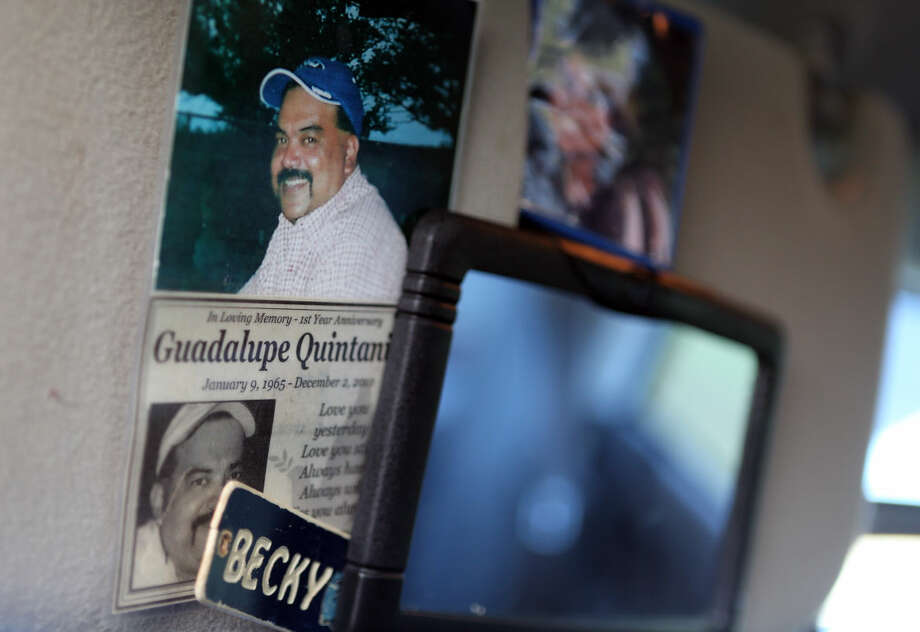 Widow Rebecca Quintanilla keeps an obituary and photo of her husband in her truck to this day as she rides along on the same busy Eagle Ford roads her deceased husband traveled as a long-time trucker. ( Mayra Beltran / Houston Chronicle ) Photo: Mayra Beltran