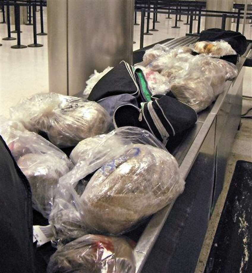 "This undated photo released by the U.S. Customs and Border Protection (CBP) shows seized 450 prohibited pork meat tamales discovered inside the luggage of a passenger arriving at the Los Angeles International Airport (LAX) from Mexico, on Nov. 2, 2015, in Los Angeles. ""Although tamales are a popular holiday tradition, foreign meat products can carry serious animal diseases from countries affected by outbreaks of Avian Influenza, Mad Cow and Swine Fever said Anne Maricich, CBP Acting Director of Field Operations in Los Angeles. (U.S. Customs and Border Protection via AP) Photo: Uncredited"