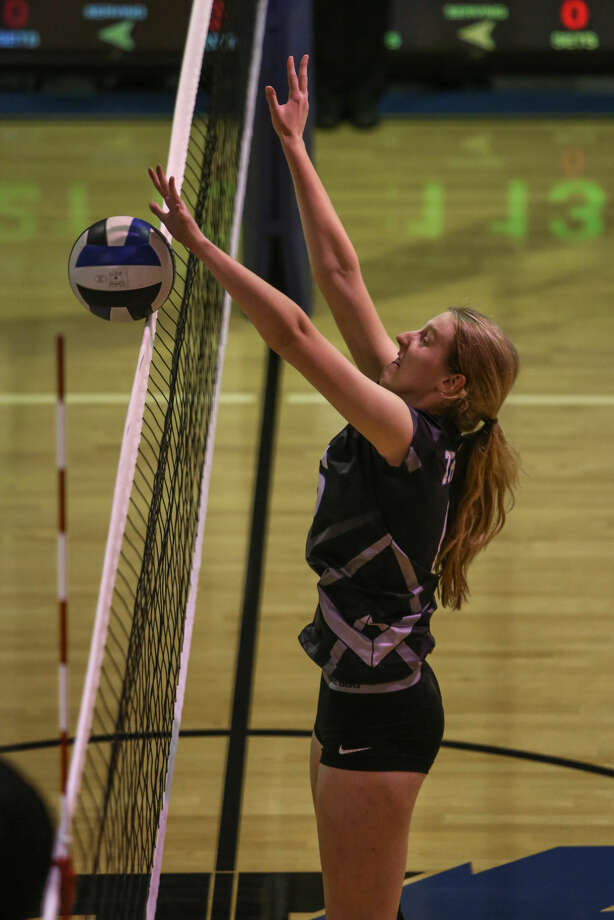 Trinity's Ashley Stroup blocks a ball during a match on Tuesday at Beal Gymnasium. Claire Heck/Special to the MRT