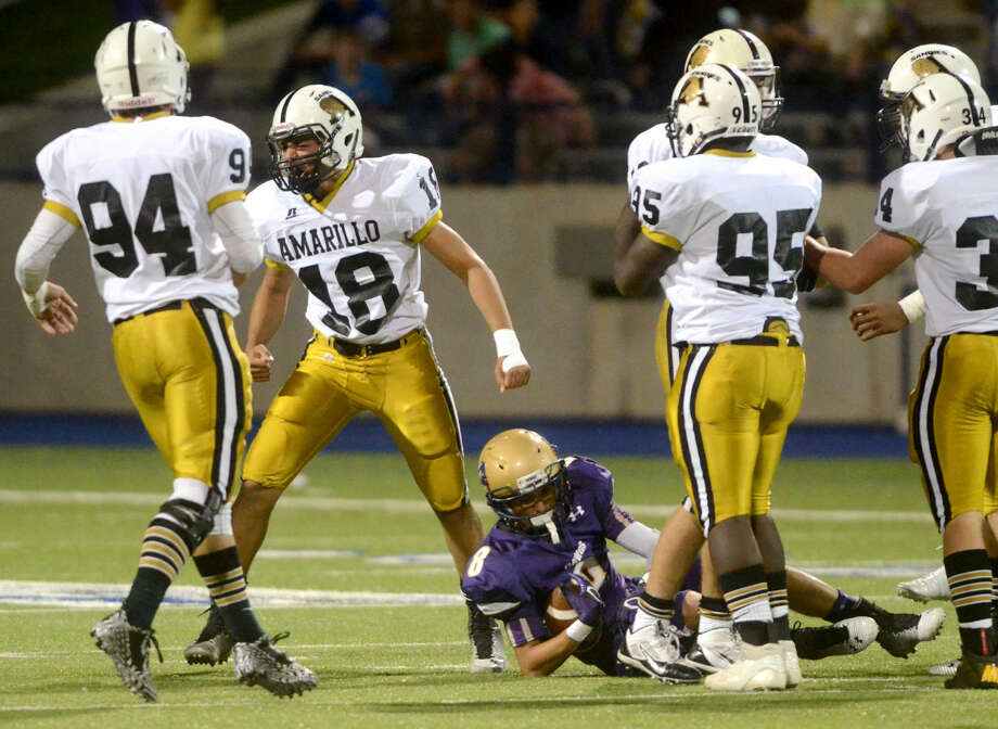 Amarillo High's Alex Landers (18) celebrates after bringing down Midland High's Matt Gallegos (8) on Friday at Grande Communications Stadium. James Durbin/Reporter-Telegram Photo: James Durbin