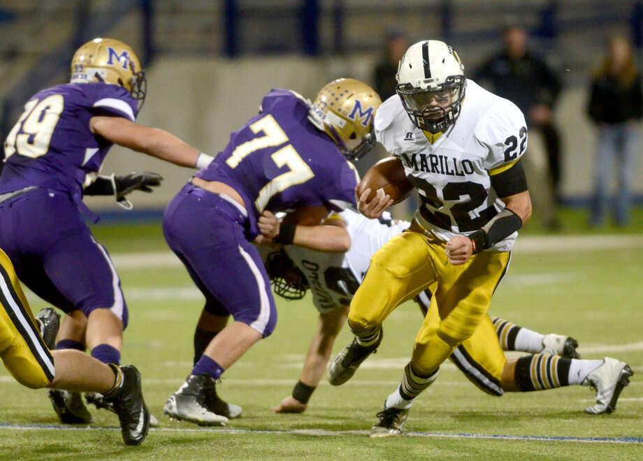Amarillo High's Spencer Simpson (22) runs against Midland High on Friday at Grande Communications Stadium. James Durbin/Reporter-Telegram Photo: James Durbin