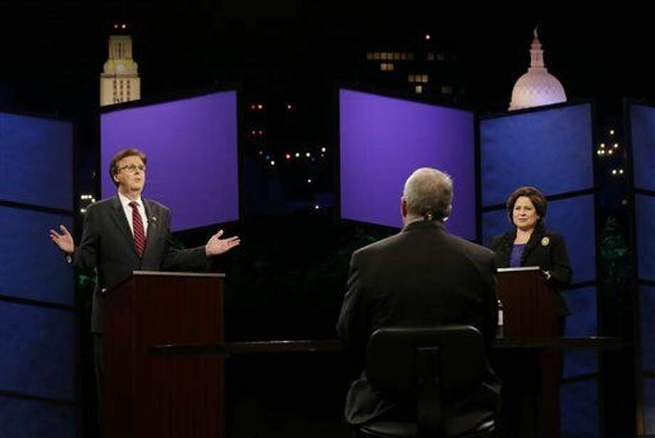 Texas Lieutenant Governor hopefuls state Sen. Dan Patrick, R-Houston, left, and state Sen. Leticia Van de Putte, D-San Antonio, right, take part in a televised debate, Monday, Sept. 29, 2014, in Austin. Photo: Eric Gay/Associated Press