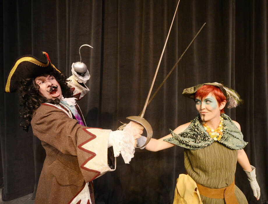 "Captain Hook (Joe Jung) and Peter Pan (Jana Tumlin) fight during rehearsal for the upcoming MCT production ""Peter Pan"" on Thursday, Nov.6, 2015, at Midland Community Theatre. James Durbin/Reporter-Telegram Photo: James Durbin"