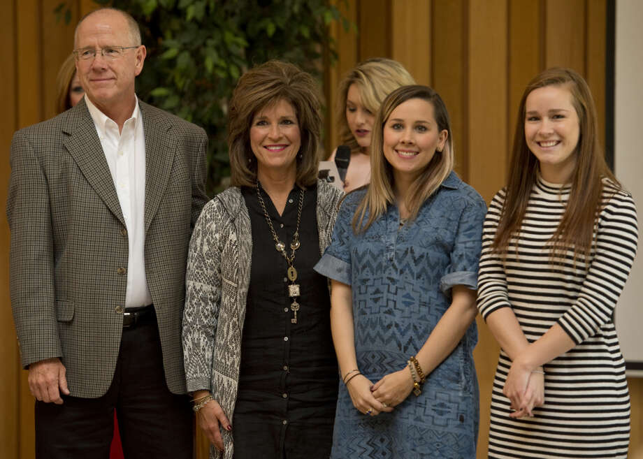 Midland family of the year, Mark and Becky McCraney, with their daughters, Rebecca and Meagan Tuesday 11-17-2015 at the Samaritan Counseling Center Family of the Year luncheon. Tim Fischer\Reporter-Telegram Photo: Tim Fischer