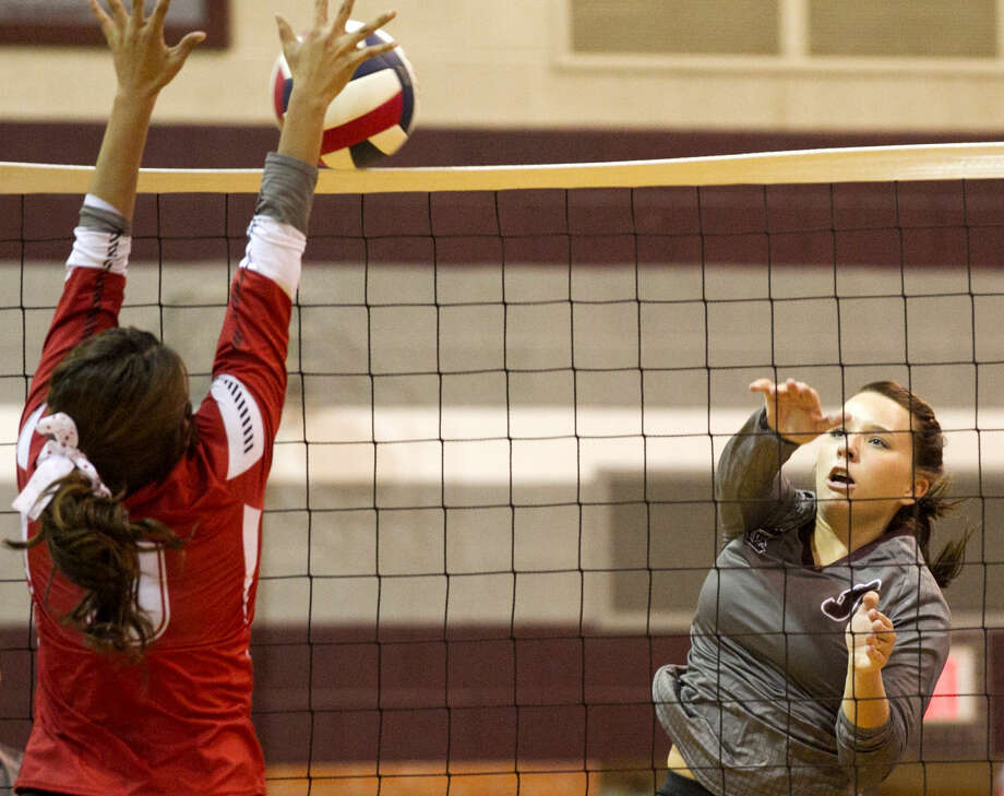 Lee High's Jen Jeter hits against Odessa High's Briana Gonzales on Tuesday at Lee High. James Durbin/Reporter-Telegram Photo: James Durbin