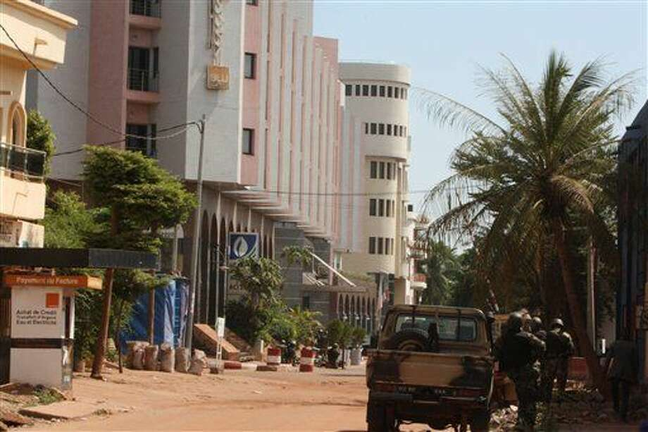 The Radisson Blu hotel, left, that was stormed by gunmen during an attack on the hotel in Bamako, Mali, Friday, Nov. 20, 2015. Islamic extremists armed with guns and throwing grenades stormed the Radisson Blu hotel in Mali's capital Friday morning, killing at least three people and initially taking numerous hostages, authorities said. (AP Photo/Harouna Traore) Photo: Harouna Traore