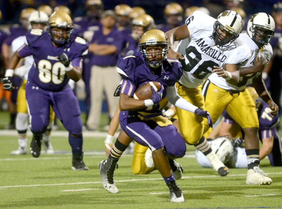 Midland High's Kahlyl Winn runs the ball in for a touchdown against Amarillo High on Friday at Grande Communications Stadium. James Durbin/Reporter-Telegram Photo: James Durbin
