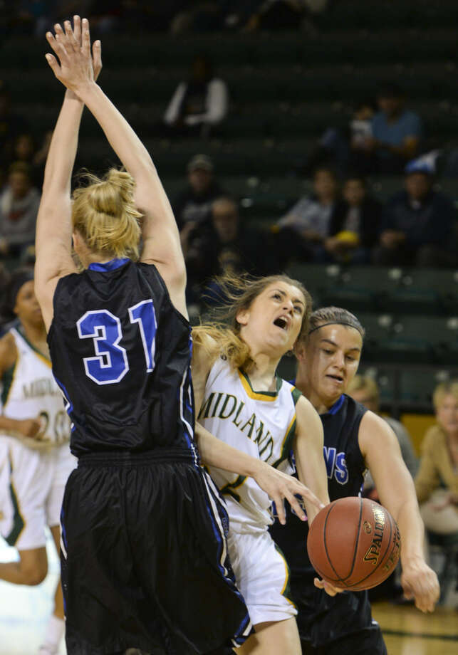 Midland College's Kayla Bretherton looses the ball as she tries to split Salt Lake's Elsa Glantz and Iva Georgieva Saturday 11-21-2015 in the championship game of the 6th annual Women's NIT at MC. Tim Fischer\Reporter-Telegram Photo: Tim Fischer