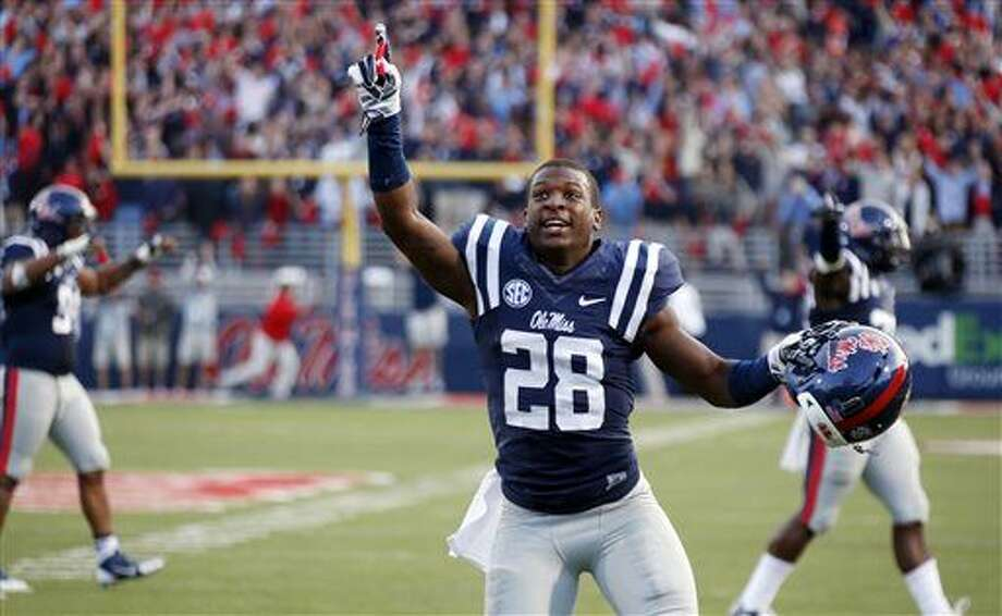 Mississippi defensive back Mike Hilton (28) celebrates his team's 23-17 win over No. 3 Alabama in an NCAA college football game in Oxford, Miss., Saturday, Oct. 4, 2014. (AP Photo/Rogelio V. Solis) Photo: Rogelio V. Solis