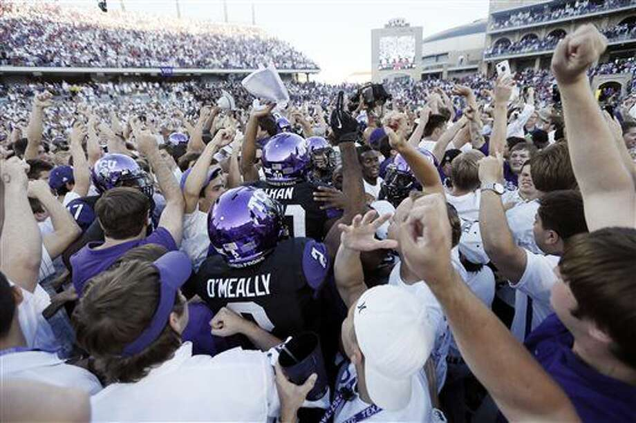 TCU players and fans celebrate a 37-33 win over Oklahoma after a NCAA college football game at Amon G. Carter Stadium, Saturday, Oct. 4, 2014, in Fort Worth, Texas. (AP Photo/Brandon Wade) Photo: Brandon Wade