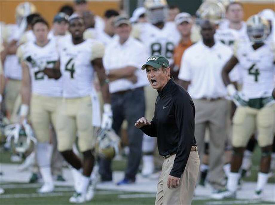 Baylor Bears head coach Art Briles, center, talks to officials during the second half of an NCAA college football game against Texas, Saturday, Oct. 4, 2014, in Austin, Texas. (AP Photo/Eric Gay) Photo: Eric Gay