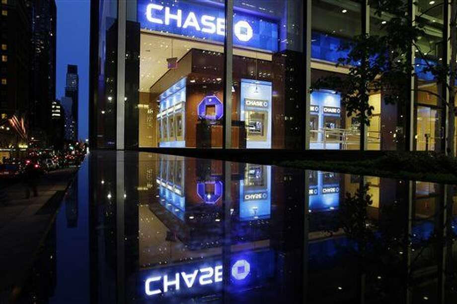 FILE - In this Thursday, May 10, 2012, file photo, automobiles pass a JP Morgan Chase building in New York. JPMorgan Chase & Co. said Thursday, Oct. 2, 2014, that a data breach affected 76 million households and 7 million small businesses. Photo: Frank Franklin II/Associated Press
