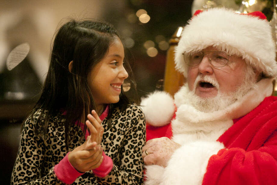 Miah Mu�iz, age 7, tells Santa about her holiday wishes during the Holiday Evening event at Midland College on Thursday. James Durbin/Reporter-Telegram Photo: James Durbin