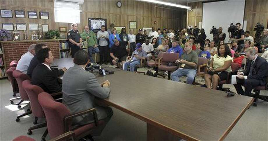 """In this Friday, Oct. 3, 2014 photo, members of the Sayreville Board of Education, seated left, hold a press conference at the Selover School in South Amboy, N.J., to address a hazing incident that """"went too far"""" and is at the center of the investigation into the Sayreville War Memorial High School football team. On Monday, Oct. 6, 2014 school superintendent Richard Labbe said the Sayreville War Memorial High School football season has been canceled amid allegations of harassment, intimidation and bullying among players. (AP Photo/ Home News Tribune, Mark R. Sullivan) On Friday October 3,,2014 Photo: Mark R. Sullivan/Home News Tribune/AP Photo: Mark R. Sullivan"""
