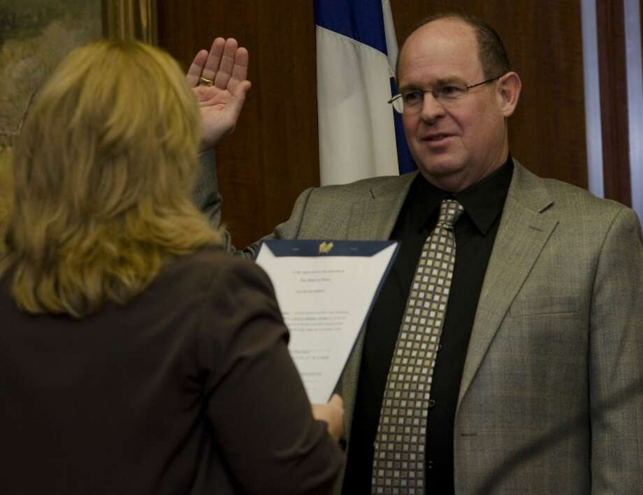 Jeff Sparks takes his oath of office Monday as city secretary Amy Turner administers the oath to new and returning council members. Tim Fischer\Reporter-Telegram Photo: Tim Fischer