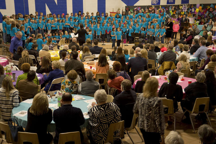 Members of Trinity School K-5 choir members sing Friday 11-20-2015 during the kickoff breakfast of the annual servant leadership initiative at Trinity School. Tim Fischer\Reporter-Telegram Photo: Tim Fischer