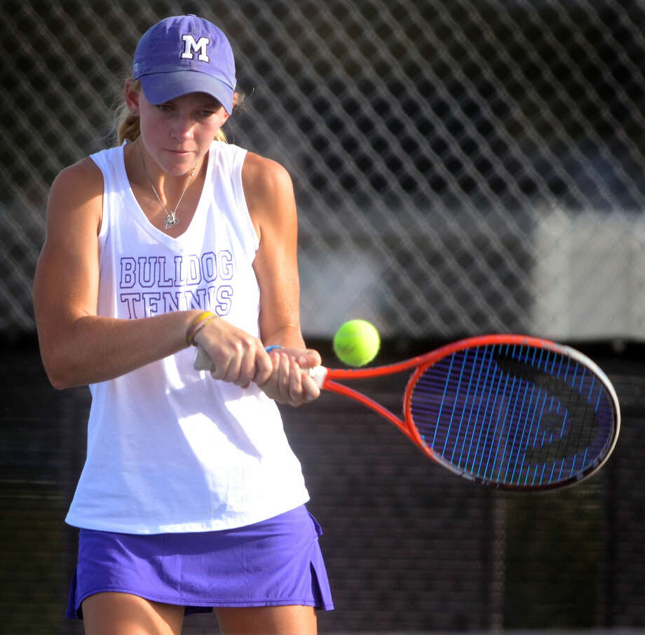 Midland High's Kate Daugherty returns a hit from a Lee High competitor during a doubles match on Tuesday at the Bush Tennis Center. James Durbin/Reporter-Telegram Photo: James Durbin