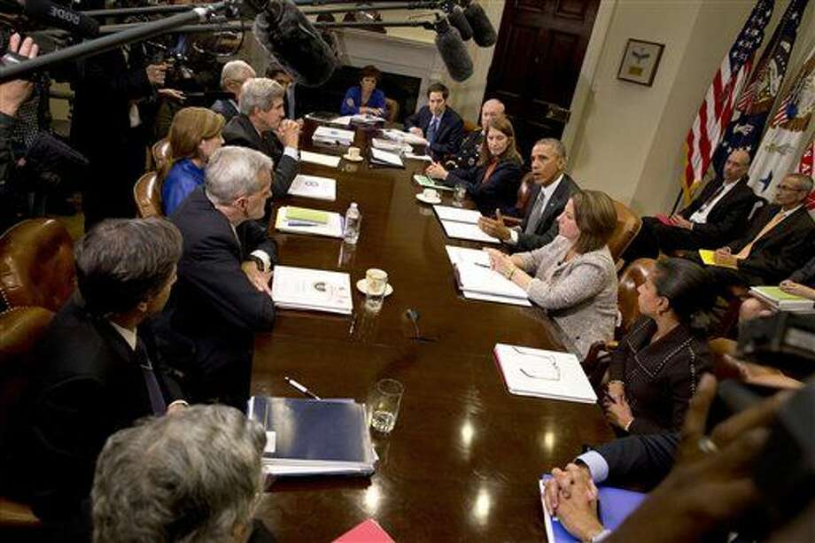 President Barack Obama meets with members of his national security team and senior staff to receive an update on the Ebola outbreak in West Africa, in the Roosevelt Room of the White House in Washington, on Monday. Photo: Jacquelyn Martin/Associated Press