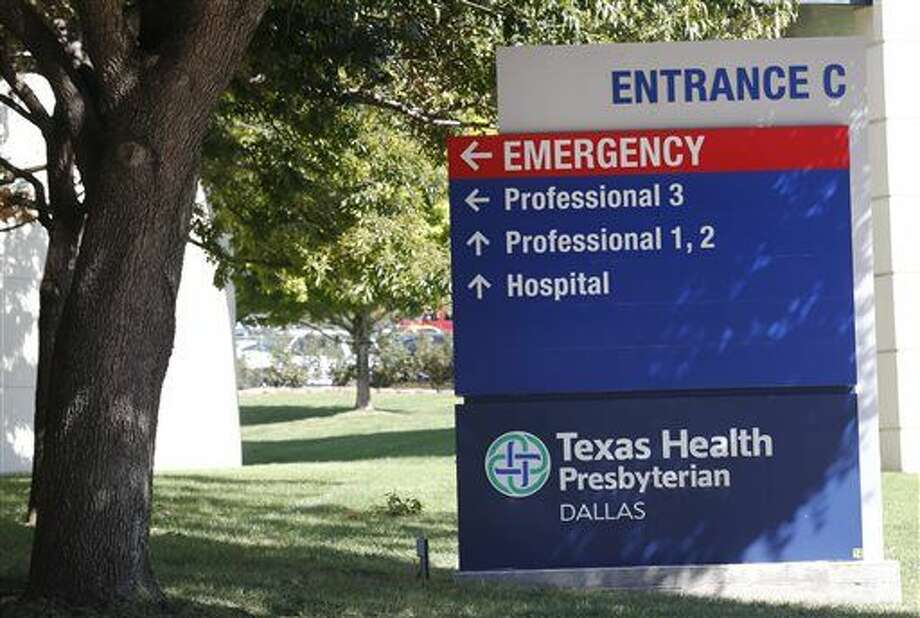 A sign marks Entrance C at Texas Health Presbyterian Hospital Friday, Oct. 3, 2014, in Dallas, where Thomas Eric Duncan, the Ebola patient who traveled from Liberia to Dallas last week, is being treated. (AP Photo/The Dallas Morning News, David Woo) Photo: David Woo