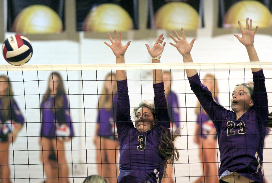 Midland High's Kyndal Cowan (3) and Jenna Gillean (23) block a hit from Permian on Tuesday at MHS. James Durbin/Reporter-Telegram Photo: James Durbin