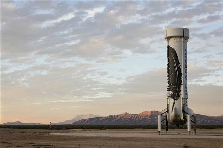 In this photo provided by Blue Origin taken on Monday, Nov. 23, 2015, an unmanned Blue Origin booster rocket sits after landing in Van Horn, West Texas. The private company announced Tuesday, Nov. 24, that it landed the rocket upright and gently enough to be used again, a milestone in commercial aeronautics. The booster rocket soared about 62 miles high and released a capsule before it came back to Earth. (Blue Origin via AP) Photo: HONS