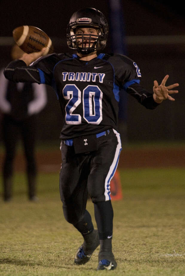 Trinity's Vincent Baiano looks to pass Friday 11-6-2015 as they take on Dallas Lutheran at Coombs Field. Tim Fischer\Reporter-Telegram Photo: Tim Fischer
