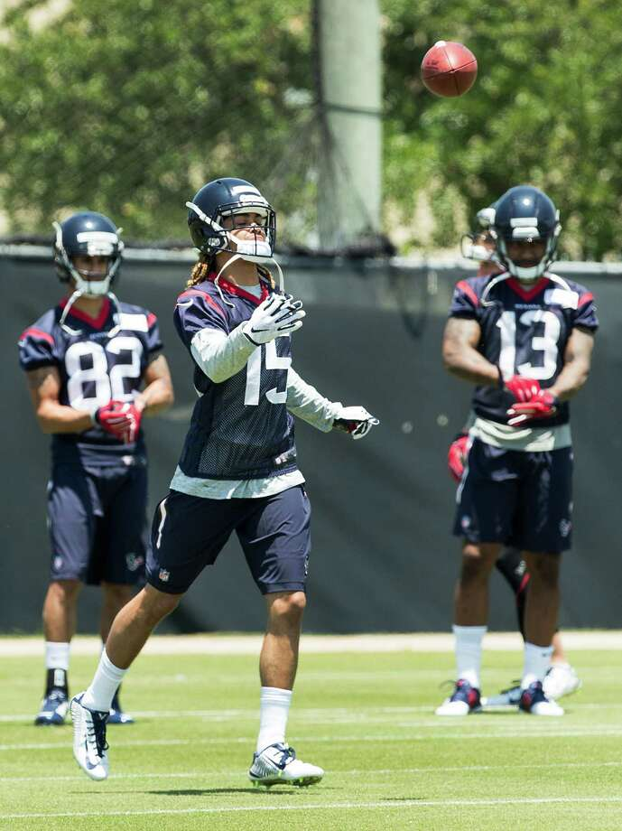 Rookie receivers Will Fuller (15) and Braxton Miller (13) have had a lot to tackle in adjusting to the pro game. Photo: Brett Coomer, Staff / © 2016 Houston Chronicle