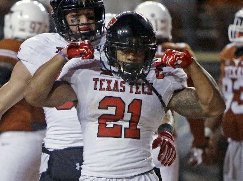Texas Tech's DeAndre Washington (21) celebrates his touchdown during the second half of an NCAA college football game against Texas, Thursday, Nov. 26, 2015, in Austin Texas Tech won 48-45. (AP Photo/Michael Thomas) Photo: Michael Thomas|AP Photo