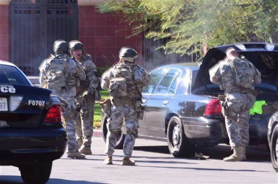 A swat team arrives at the scene of a shooting in San Bernardino, Calif. on Wednesday, Dec. 2, 2015. Police responded to reports of an active shooter at a social services facility. (Doug Saunders/Los Angeles News Group via AP) MANDATORY CREDIT Photo: Doug Saunders