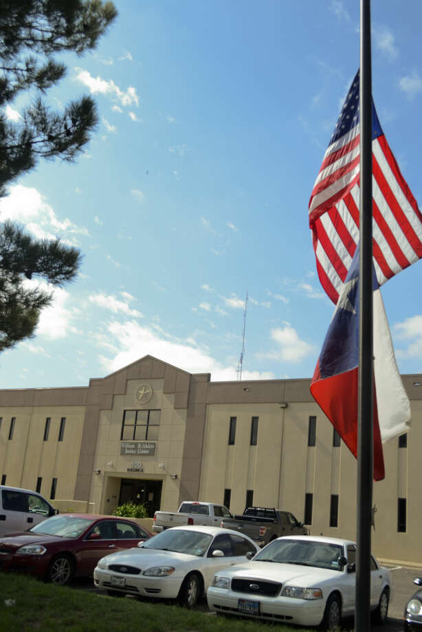 Flags fly at half staff Friday outside Midland County Sheriff Department in honor of their fallen Deputy Sgt. Mike Naylor. Tim Fischer\Reporter-Telegram Photo: Tim Fischer