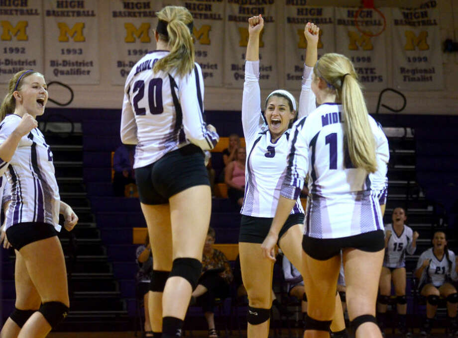 From left, Midland High's Jenna Gillean (23), Claire Lancaster (20), Kyndal Cowan (3) and Konner Wood (10) celebrate after scoring a point against Abilene High earlier this season. James Durbin/Reporter-Telegram Photo: JAMES DURBIN
