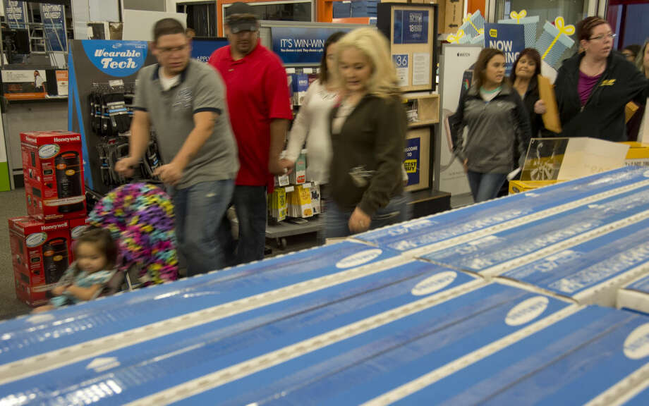 Shoppers rush in Thursday 11-26-2015 as Best Buy opens the doors at 5pm to start the Black Friday sales Thursday evening. Tim Fischer\Reporter-Telegram Photo: Tim Fischer