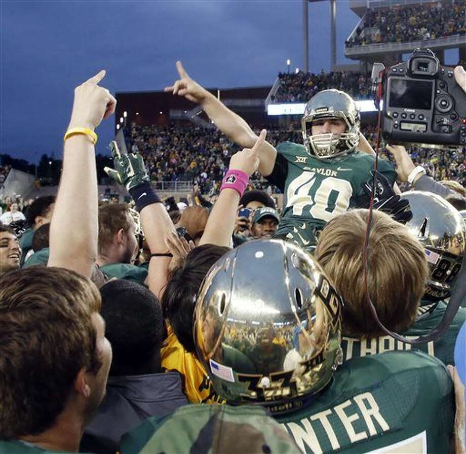 Baylor place kicker Chris Callahan (40) is lifted up by the team after connecting for the game-winning field goal against TCU in the second half of an NCAA college football game, Saturday, Oct. 11, 2014, in Waco, Texas. Baylor won 61-58. (AP Photo/Waco Tribune Herald, Rod Aydelotte) Photo: Rod Aydelotte