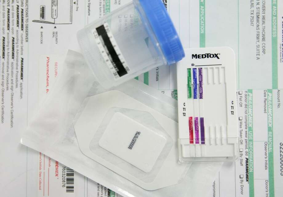 Drug patches and Urine Analysis Dip Test are among the tools that adult probation officers at the Midland Judicial District's Community Supervision and Corrections Department are using to test if probationers are taking drugs. Photo Illustration by Cindeka Nealy/Reporter-Telegram Photo: Cindeka Nealy